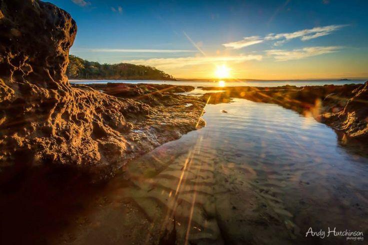 Sun rays over the Murrays Beach, Jervis Bay
