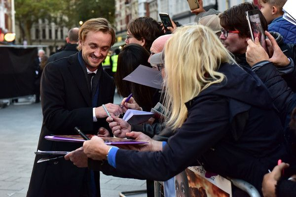 Tom Felton Photos - Actor Tom Felton signs autographs as he attends the 'A United Kingdom' Opening Night Gala screening during the 60th BFI London Film Festival at Odeon Leicester Square on October 5, 2016 in London, England. - 'A United Kingdom' - Opening Night Gala - 60th BFI London Film Festival