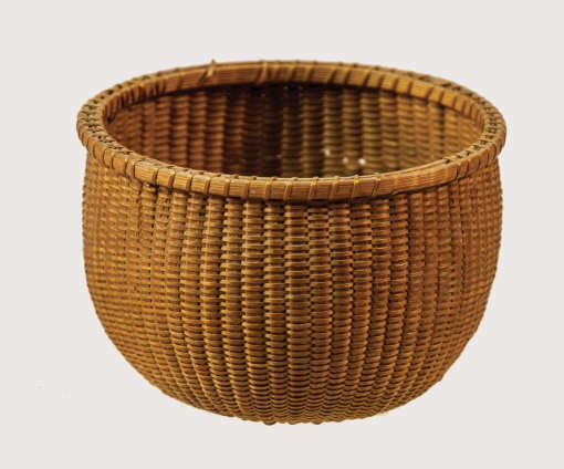 """Lot 113: Miniature Round Basket Estimate: $800 – $1,200. Realized: $600 hammer.   Black ash splint, single wrapped rim, round slope inverted base, extremely fine weavers, some wrap on rim is missing and a few breaks in the body, possibly had a hoop handle at one time, (note: this is an exceptionally fine Shaker miniature basket), 2″ h, 3″ dia, (Ed Clerk collection). Exhibited: """"Shaker, Original Paints & Patinas"""", Catalog #47, November 17, 1987 – January 10, 1988, Muhlenberg College, Center…"""