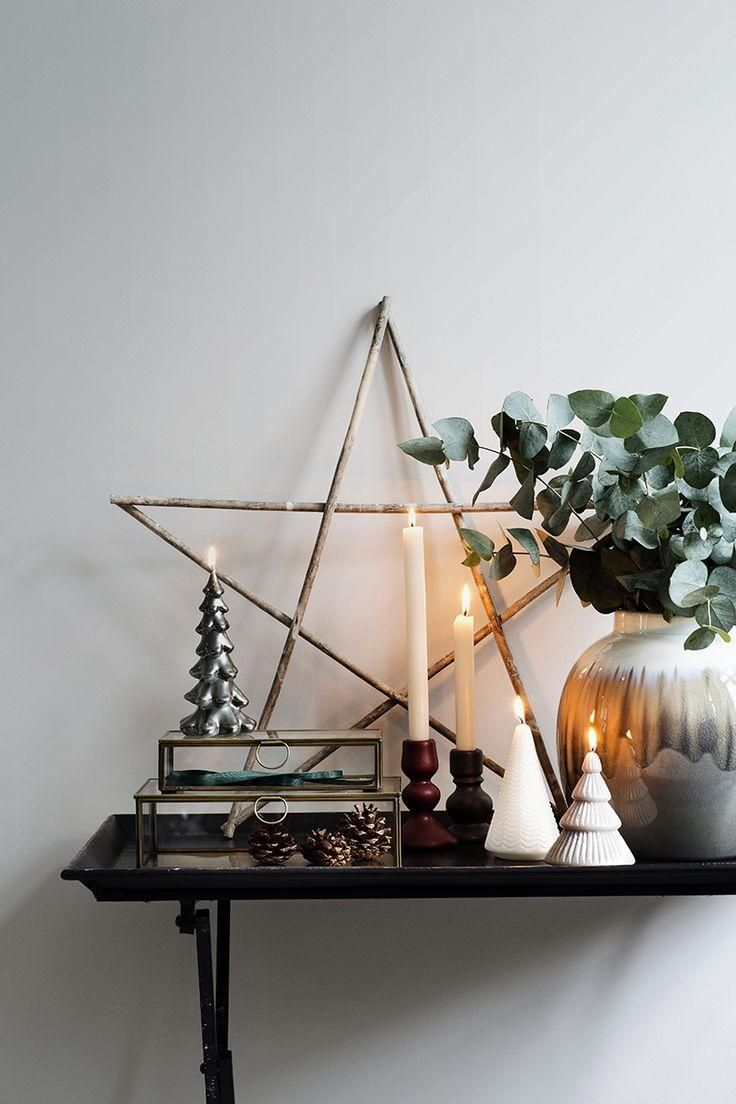 A rustic DIY branch star for a beautiful yule display this Christmas -- also such a great decor idea for a fireplace mantle!