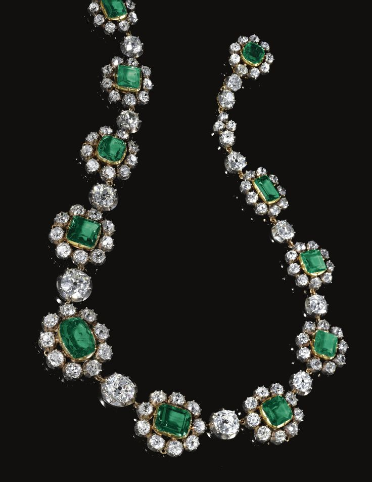 Very fine emerald and diamond necklace and a pair of earrings, late 19th century | This demi-parure was purchased by Albert, 8th Prince of Thurn und Taxis around 1890. At that time he also purchased the 'Empress Eugenie Tiara' as a wedding present for Austrian Archduchess, Margarete, whom he married on July 15th in that year. The tiara, designed by Gabriel Lemmonier in 1853, was part of the French crown jewels and is now in the Louvre in Paris.