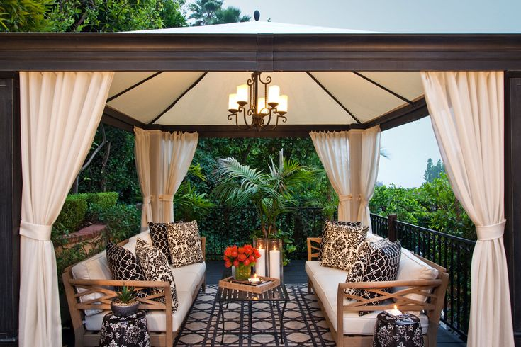 Gorgeous-Gazebo-Canopy-mode-Los-Angeles-Transitional-Patio-Decorators-with-black-bold-prints-chandelier-curtain-panels-damask-iron-railing-pool-cabana-seat-cushions-settee.jpg 990×660 pixels