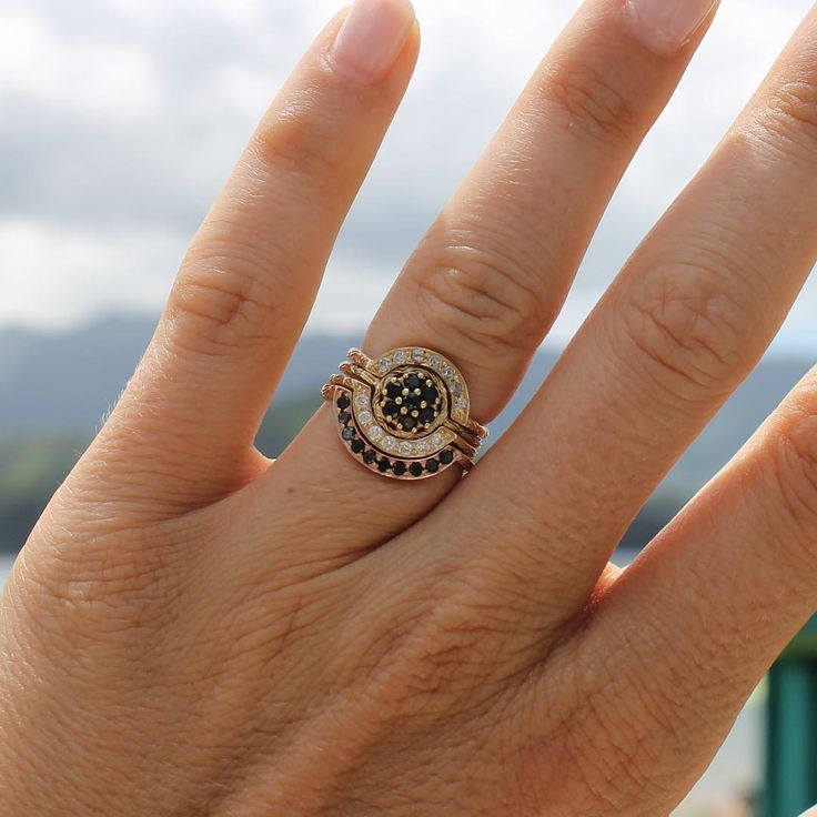Atreyu ring in the center with a set of three custom wedding bands again the beautiful backdrop of Kauai. Thanks & congrats to @swellpresspaper #digbyido #ionamarryyou