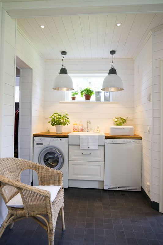 laundry room with great design.Granite tile floor, fabulous light fixtures- love the sink
