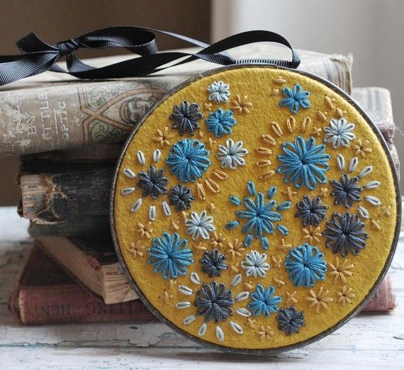 Love the colors and the felt and the pattern on this one. Hand Embroidered Wool Felt Hoop Art in Her Random by lovemaude on etsy
