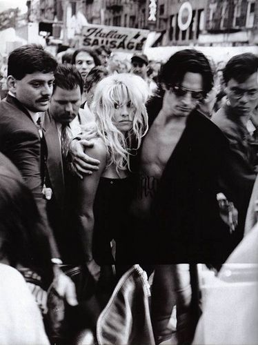 Pamela Anderson & Tommy Lee, 1995. I love this photo. I love how it captures Pamela's vulnerability