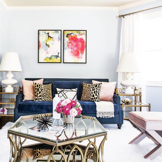 A chic mix of textures tied together with leopard print pillows and a crush-worthy blue sofa