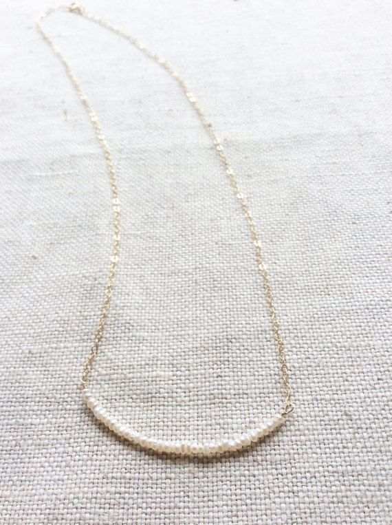 This is a tiny pearl necklace made of 1.5mm fresh water pearl and gold filled chain.