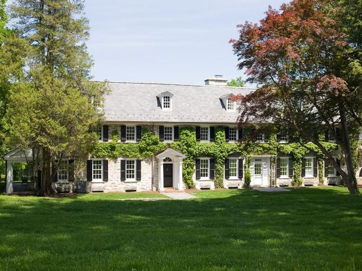 Georgian Colonial Mansion stone georgian colonial mansion with classic black shutters and