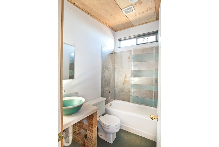 cool bathroom using non-traditional elements to finish ...