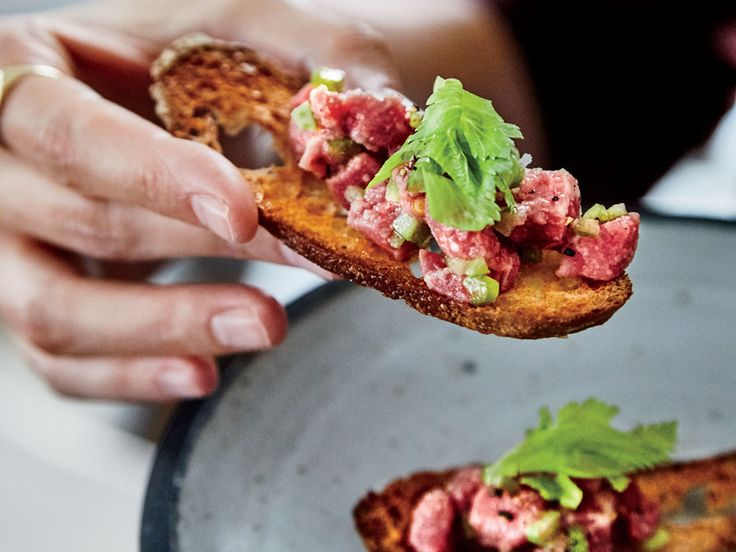 Chef Brooks Reitz's delicious Beef Tartare gets great texture from crumbly cheese and crunchy celery. Find the recipe at Food & Wine.