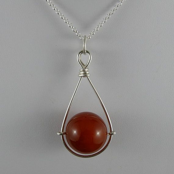 Items similar to Hand Forged Carnelian Spinning Pendant on Etsy
