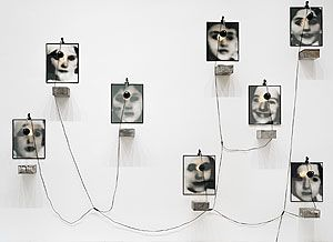 Christian BOLTANSKI France born 1944  Pourim réserve  [Purim reserve] 1989 Installation gelatin silver photographs, wall lights, tin biscuit boxes and white linen 8 gelatin silver photographs, 8 tin biscuit boxes, 8 lamps, white linen. installed (variable) 360.0 (h) x 300.0 (w) cm not signed,not dated