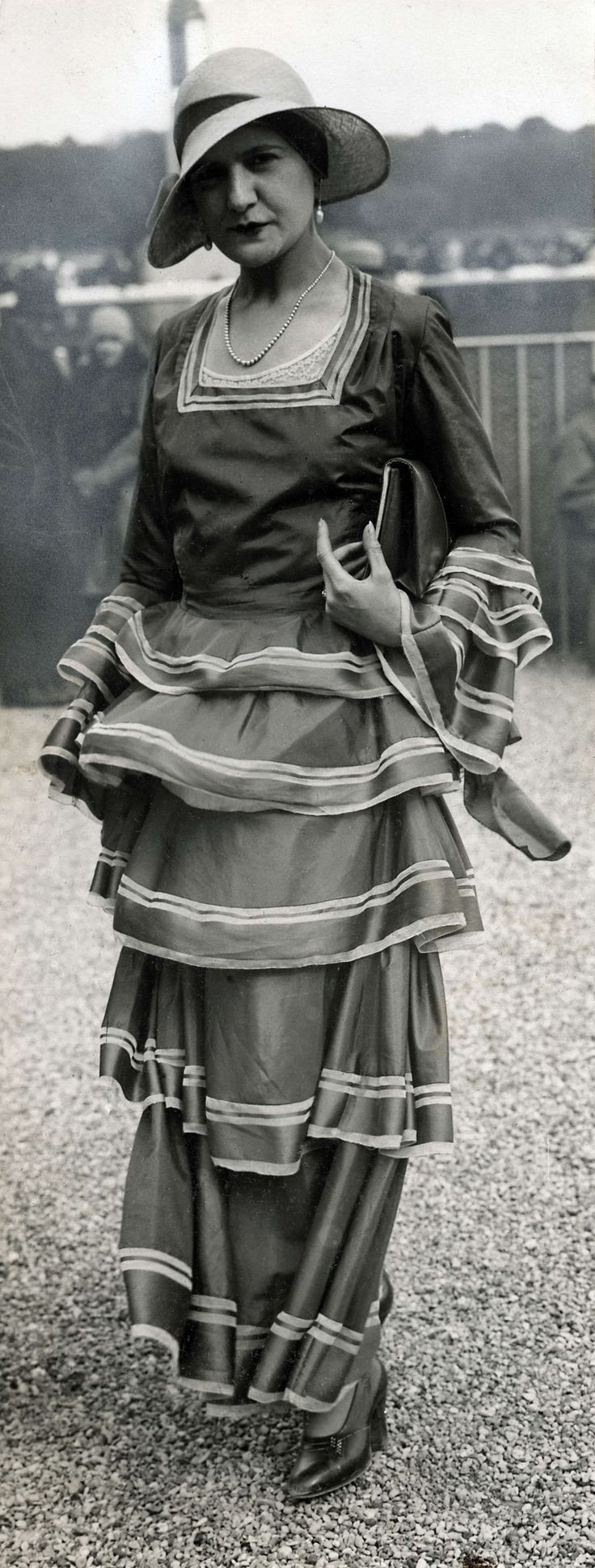 A woman at Longchamp Racecourse in France 1930.