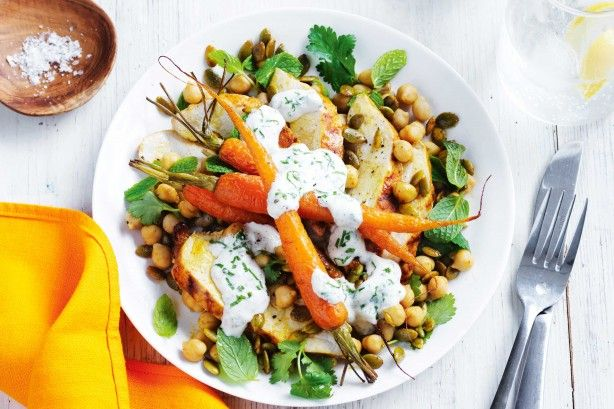For the perfect finish, drizzle this spiced chicken and roast carrot salad with mint yoghurt dressing and toasted pepitas.