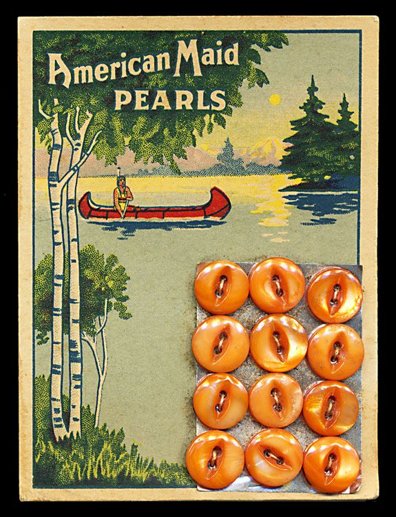 American Maid orange Mother of Pearl buttons.