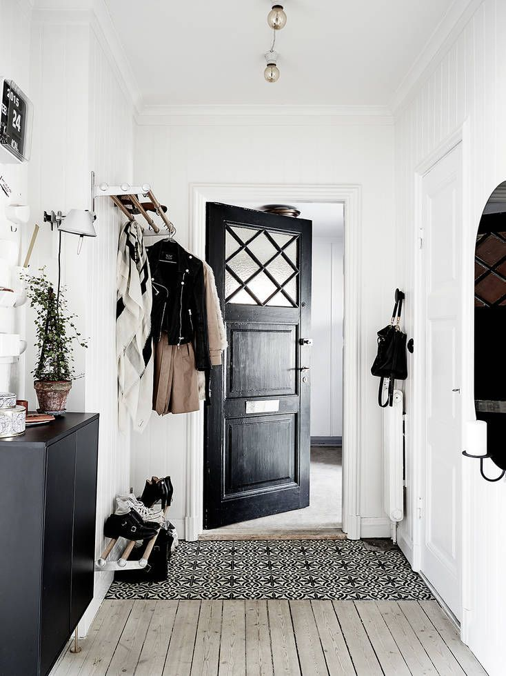 black and white organized entryway