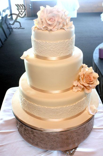 Black magic roses instead of ivory, black lace maybe ~EP Vintage ivory wedding cake with lace accents