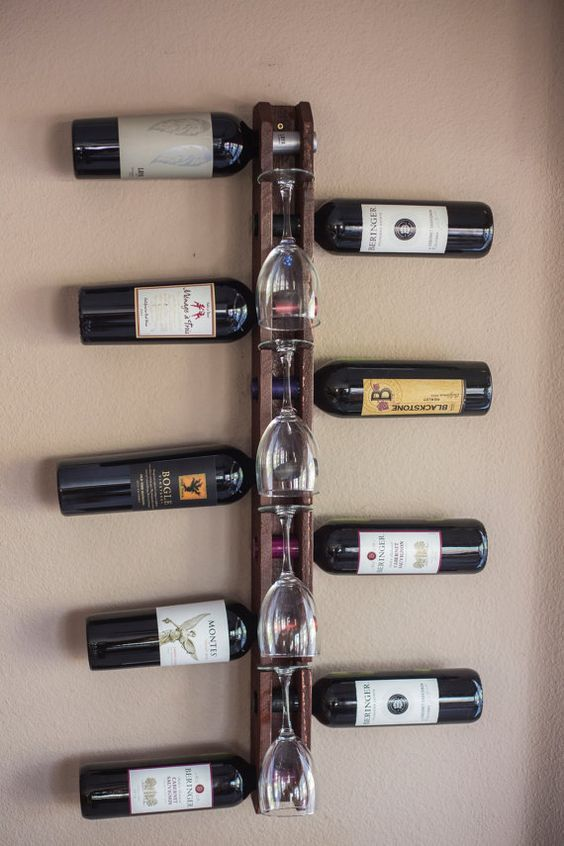 Handmade Wood Wall Mounted Vertical Wine Rack holds 9 bottles and 4 wine glasses The wine rack is made of pine, carefully hand crafted in the: