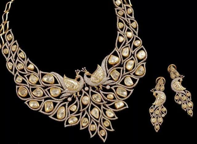 A stunning peacock-set for the new brides. #Jewellery #Jaipur #Polki #Diamonds