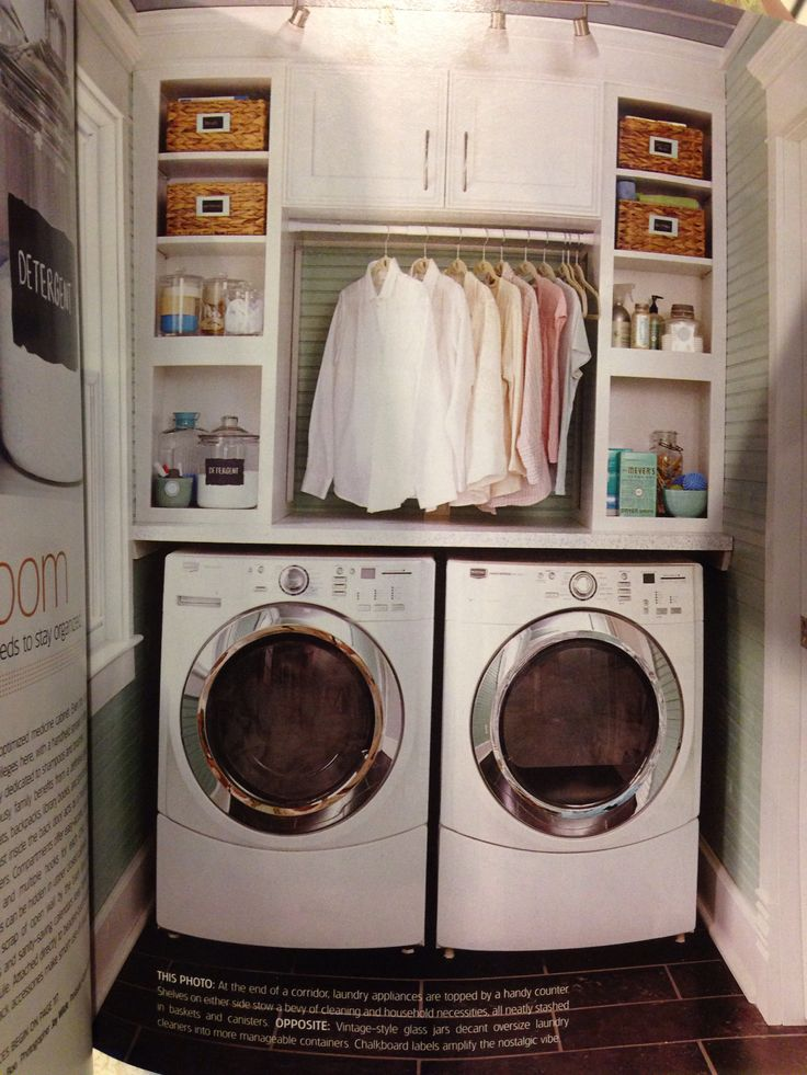 Built-In cabinets above the washer and dryer with baskets, canisters, and a place to hang clothes that also doubles as an ironing space