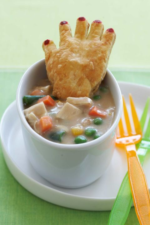 Chicken Pot Pie With Crawling Hands: This savory pot pie is packed with veggies and protein to keep your little ghost or goblin well nourished for the night ahead. Serving this spooky and creepy Halloween dinner recipe will be a hit with your family. Find more easy and spooky Halloween dinner ideas and recipes for your family and Halloween party here.