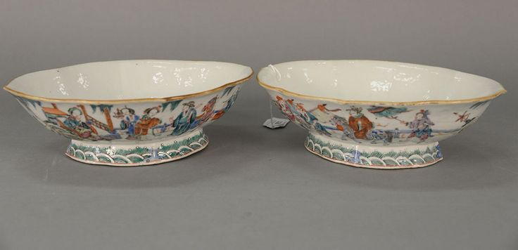 Pair of Chinese porcelain footed serving dishes with enameled Guanyins in courtyard.