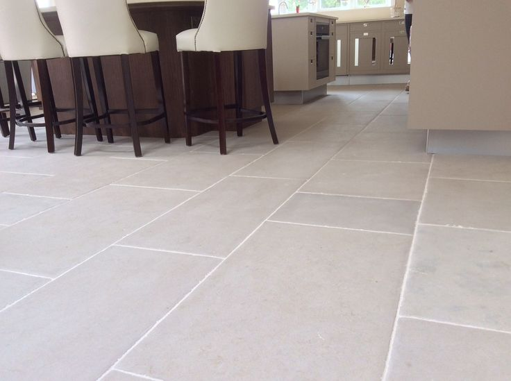 Luberon stone flooring, hand distressed antiqued limestone beige brown in tone with a light hint of grey. An authentic stone floor tile which will compliment any colour pallet. The Kitchen had underfloor heating and the stone cut to 20 - 23 thickness.