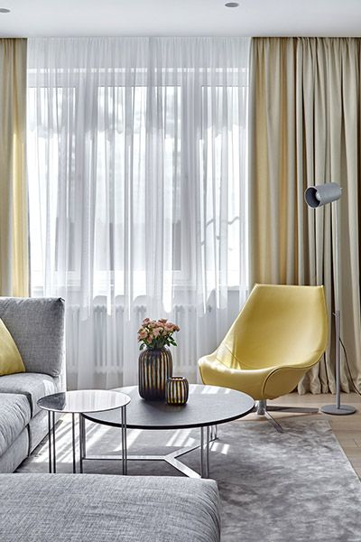 Colorful furniture pieces make this Moscow apartment feel warm, comfortable and exude and air of sophistication - interior design by Alexandra Fedorova