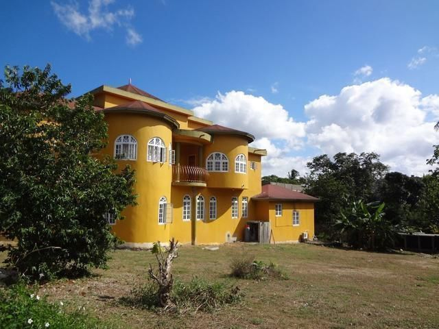 This spacious custom built home is located in Upton, St. Ann, behind the Sandals Golf Club. Comprised of 7 bedrooms, 7.5 bathrooms and 5 balconies