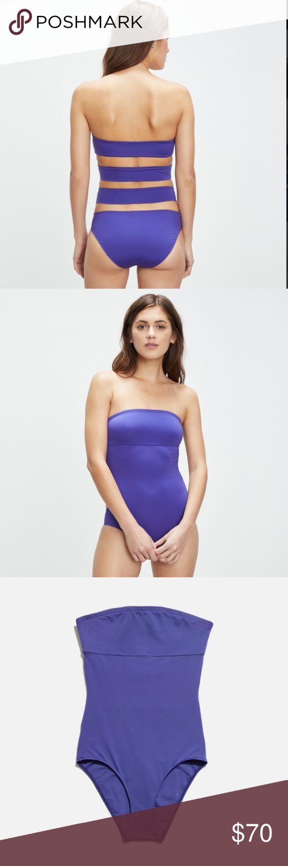 Onia Allie one piece bathing suit size Small swim Purple one piece with cut out band in the back, strapless. New with tag, retail $150 from Onia. Silicone lining inside to keep bathing suit in place. Onia Swim One Pieces