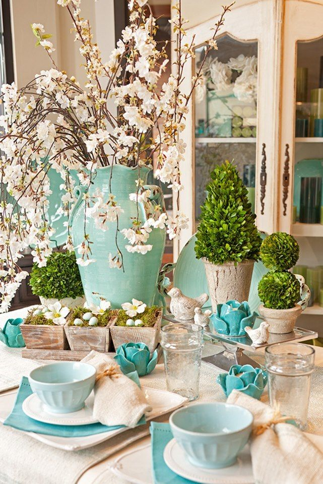 This is too beautiful for words. I just love this blue and just a tinge of pink on this table. The cherry blossoms make for a very spring seasonal table setting.