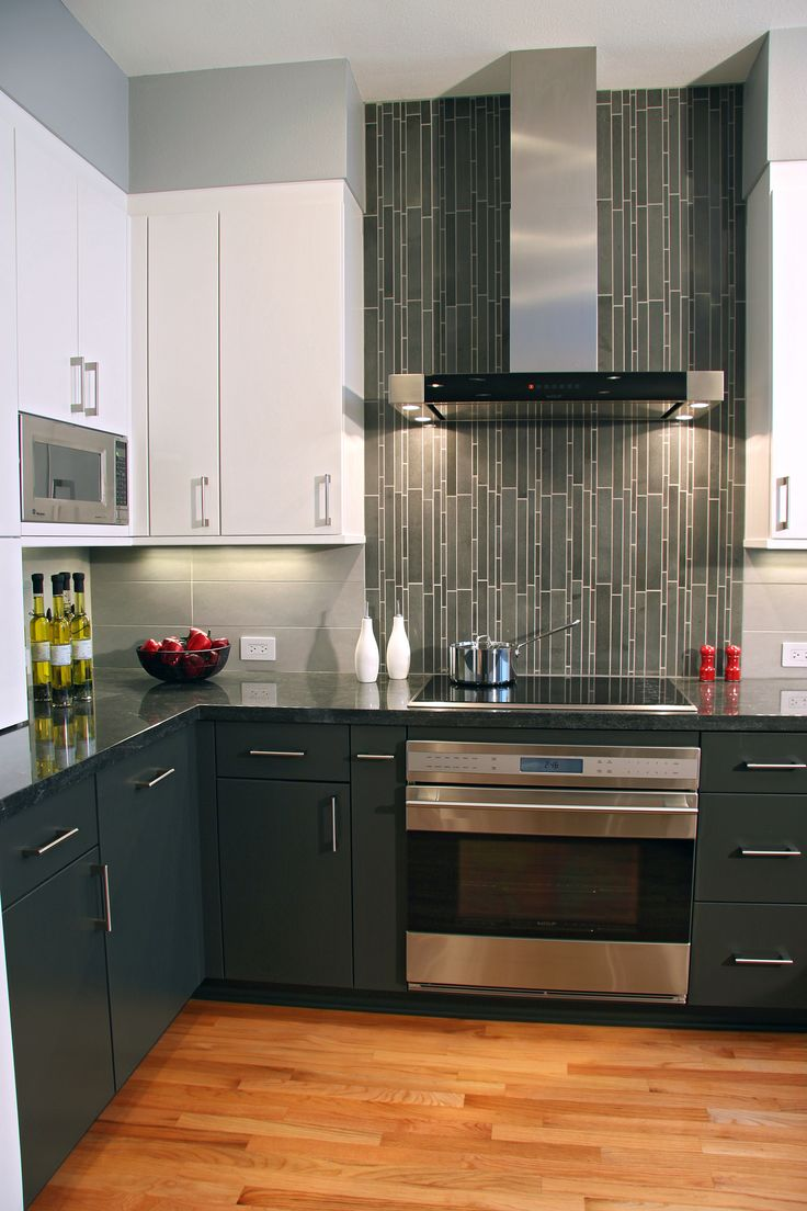 Contemporary Kitchen: Vertical tiles are a perfect accent for the range backsplash in this high style kitchen!