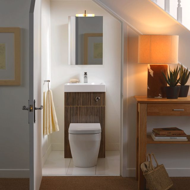 Toilet under the stairs