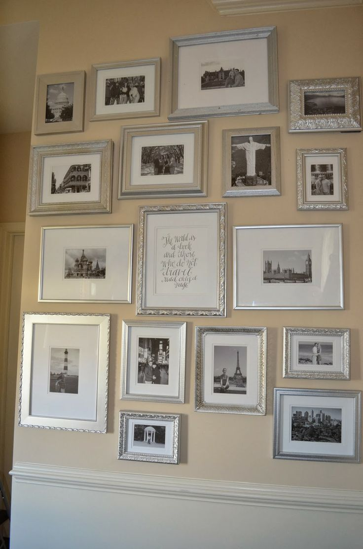 travel gallery wall with silver frames and black and white photos via The Cheerful Home