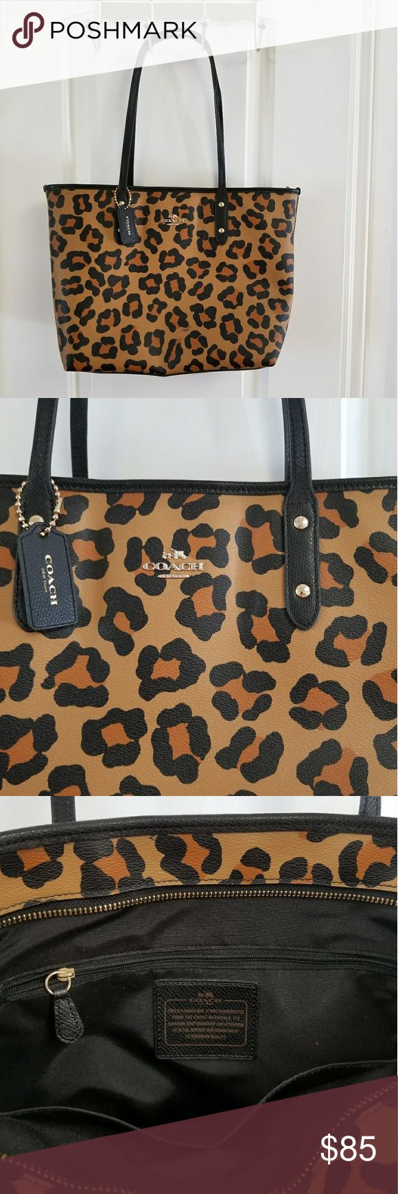 Coach leopard purse Coach leopard purse, medium to large shoulder bag. Black strap and coach tag. Embellished with coach logo in gold. Inside has 2 open seemed pockets, one zipper pocket, and gold zipper along entire inner top seam for security. New, never used, but missing tag. Coach Bags Shoulder Bags