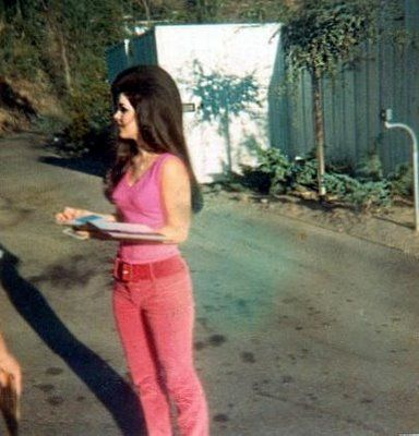 Priscilla Presley Pictures young | Casual Priscilla wearing hop pink sleeveless top and bell bottom red ...