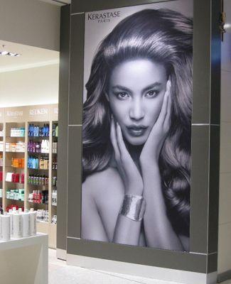 Brandframe illuminated in shopping mall.