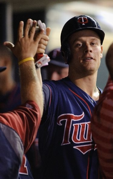 Justin Morneau #33 of the Minnesota Twins celebrates scoring against the Seattle Mariners during the seventh inning on August 29, 2012 at Target Field in Minneapolis, Minnesota. The Twins defeated the Mariners 10-0