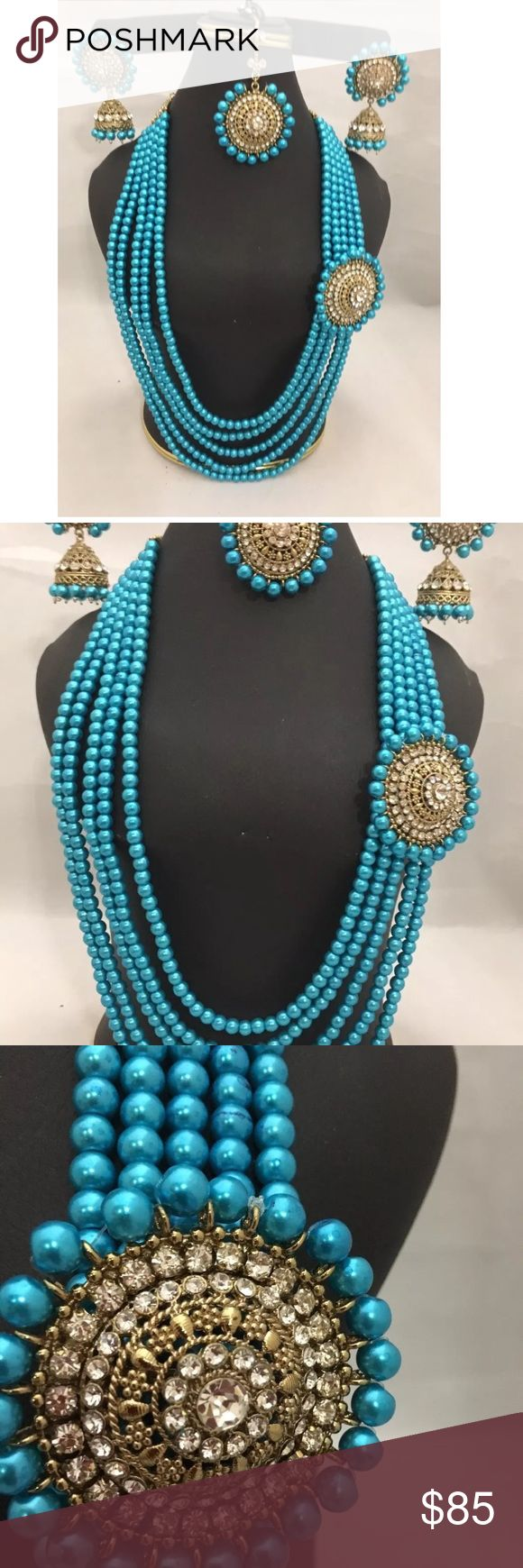 NWOT pearl layer Mughal  jewelry set New 5 layers of blue color Imitation pearl beads attached with rhinestones pendent . Set include jhumki earrings , tikka and long necklace .  Please ask any question before bidding all sales are final no return accepted.  Thank you Jewelry Necklaces