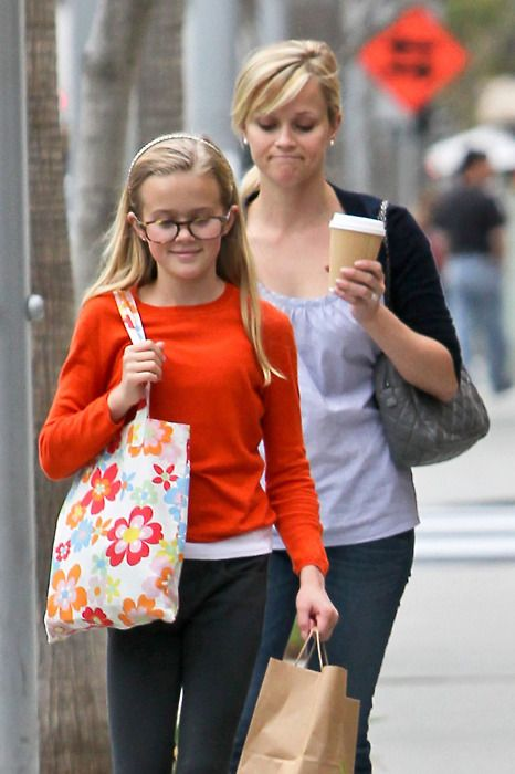 """it's crazy how much reese's daughter looks like her. talk about a """"mini-me""""! so cute!!!"""