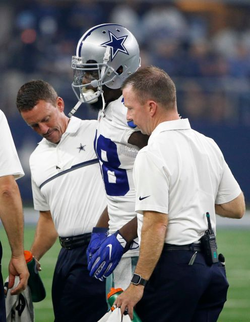Dallas Cowboys wide receiver Dez Bryant, center, is helped off the field after suffering an unknown injury in the first half of an NFL football game against the Chicago Bears, Sunday, Sept. 25, 2016, in Arlington, Texas.