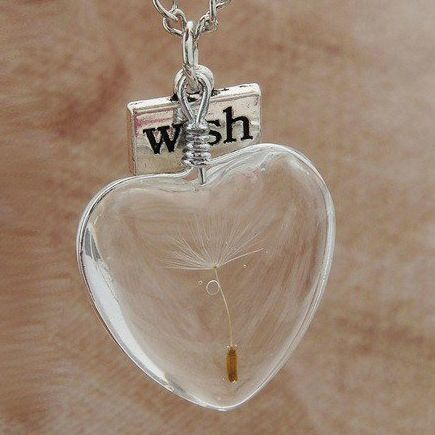 Solid glass heart pendant with a single dandelion seed and a 'wish' charm. Available at http://green-lizzy.com/store/product/dandelion-wish-heart/