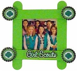 Jumbo Craft Stick Frame. Follow instructions to make a colorful Girl Scout frame using jumbo craft sticks with bottle cap decorations. Directions available at MakingFriends.com