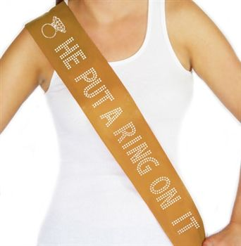 He liked it, so he put a ring on it! Let the world know with this rhinestone sash.Get it for the bride to wear at her bridal shower, bachelorette party, or the morning of her wedding.