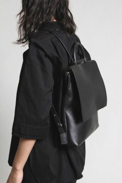 Stylish and classy, square black leather backpack