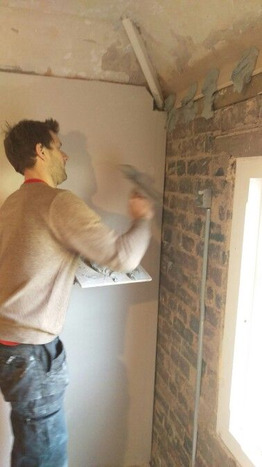 """Throwing on the """"dot and dab"""" plasterboard adhesive - there's afirst time for everything!"""