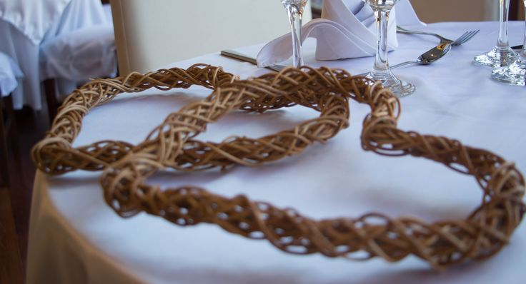 Wooden hearts on bride + groom table