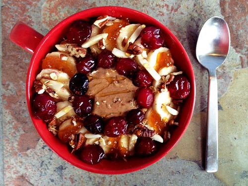 with almond butter, banana slices, roasted cranberries, apricot jam ...