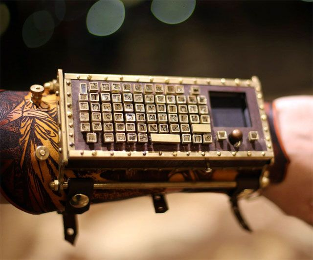 Functional steampunk keyboard arm guard. The ability to control my gadgets in a stylish, yet possibly impractical manner? Count me in!